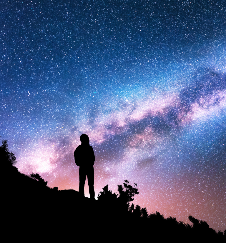 visionary-standing-against-night-sky